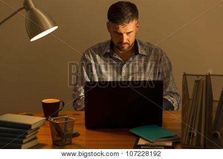 Handsome Guy Sitting At Desk
