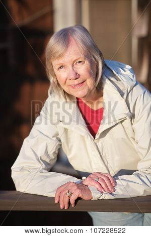 Woman Leaning On Railing