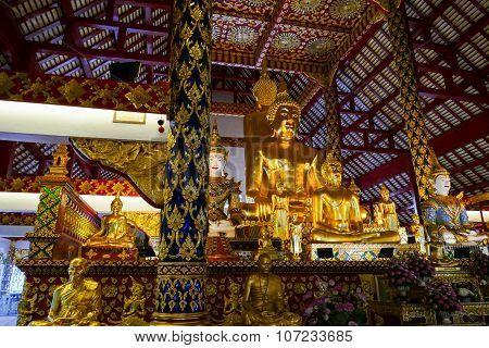 Golden Buddha Statue And Angel Statue