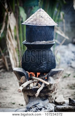 Pot Boiling Water For Cooking Sticky Rice On The Fired Stove