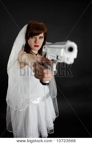 Serious Bride Take Aim With A Pistol