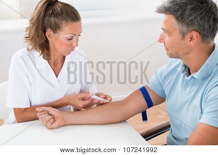 Doctor Injecting Injection To Patient