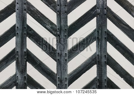 Tudor house wall with half timber strong wood in zig zag shape feature