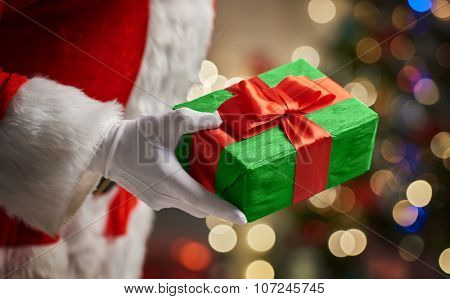 Hands of Santa Claus with Christmas present