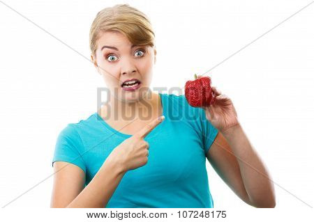 Disgusted Woman Holding And Showing Old Wrinkled Peppers, White Background