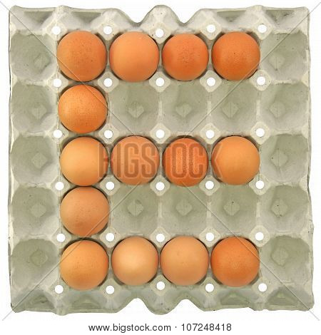 A Letter E From The Eggs In Paper Tray