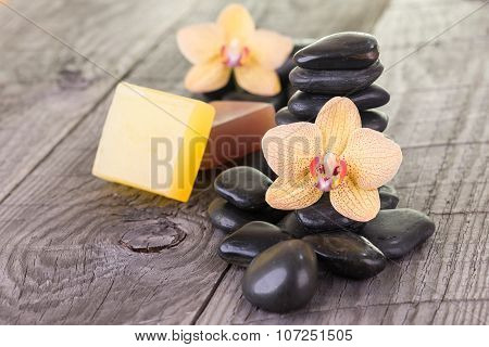 Yellow Moth Orchids, Soaps And Black Stones