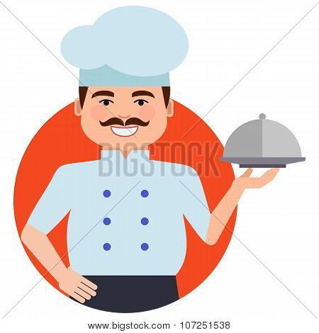 Smiling male chef with closed cloche