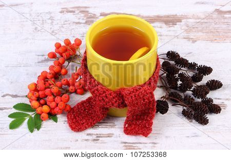 Cup Of Tea With Lemon Wrapped Woolen Scarf, Autumn Decoration, Warming Beverage For Flu