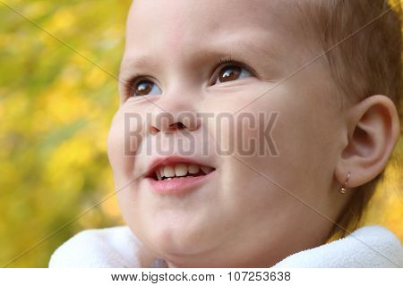 Close Up Portrait Of Beautiful Little Girl Near Yellow Trees At Autumn Day