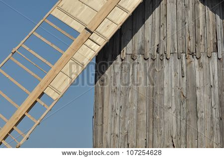 Wooden Windmill. Monument. Antique Mill Powered By The Wind