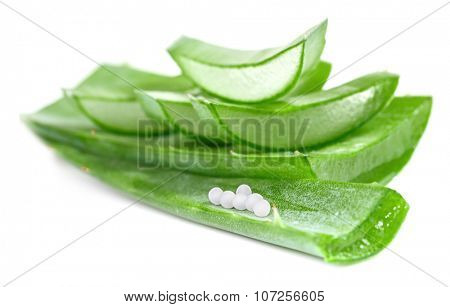 Sliced aloe leaves with homeopathy globules