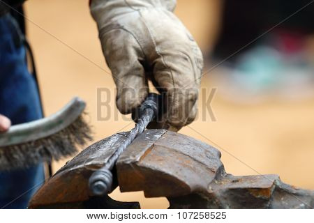 Closeup Of Blacksmith Hand Brushed Metal Forged Products Outdoor