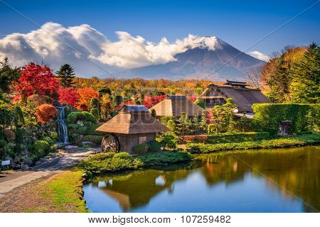 Oshino, Japan historic thatch houses with Mt. Fuji in the background.