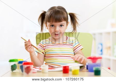 Kid Painting With Paintbrush