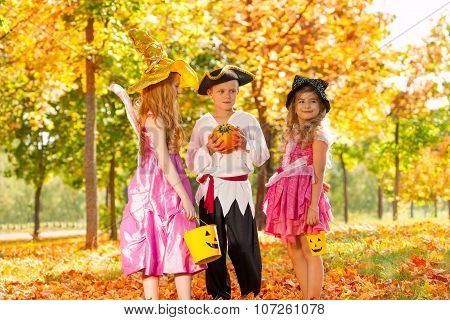 Happy children in Halloween costumes standing