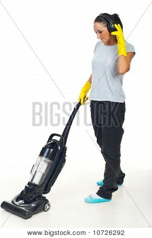 Woman Enjoy Music And Doing Housework