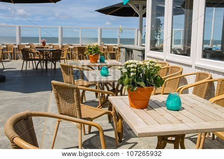 Flowers In Pot And Candles On The Tables Of Beach Cafe. Zandvoort, The Netherlands