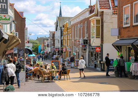Tourists Wakling On The Popular Shop Street Kerkstraat In Zandvoort, The Netherlands.