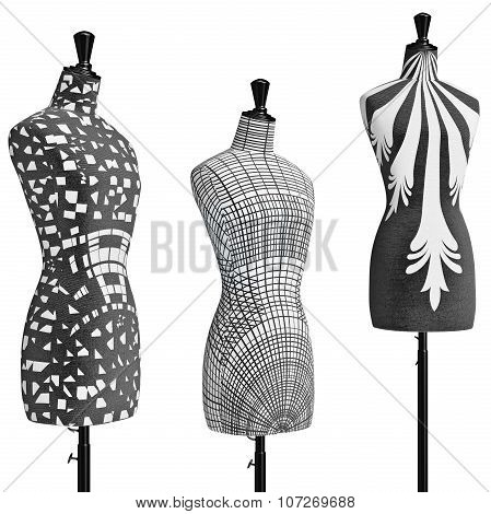 Female mannequins on tripod with monochrome ornament, close view
