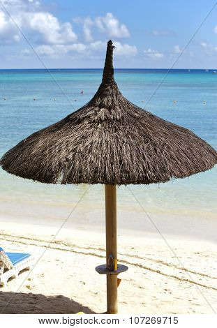 Sun-protection umbrellas beach sea . Mauritius