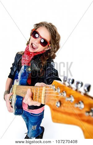 Cute teen girl playing her electric guitar. Isolated over white.