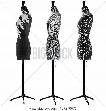 Female mannequins with black and white ornaments, side view