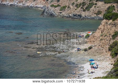 Masua Beach, Italy - August 19: Masua Rocked Beach In Nebida With People In Summertime Seen From The