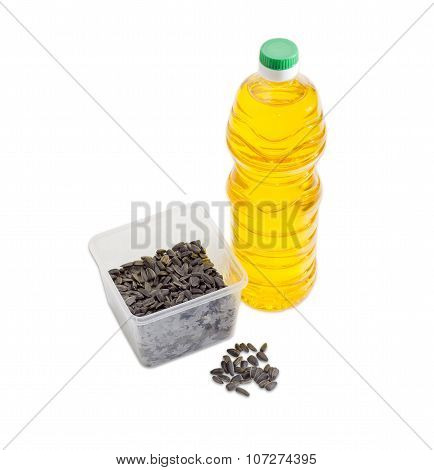 Sunflower Seeds In Plastic Tray And Bottle Of Sunflower Oil