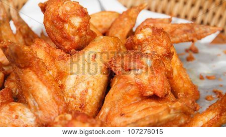 Fried chicken wings put on oil blotting paper