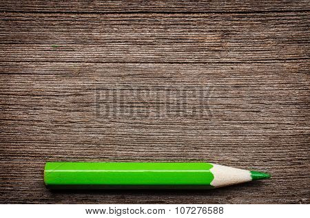 green pencil , place for tex