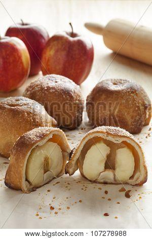 Fresh baked traditional Dutch apple dumplings in half