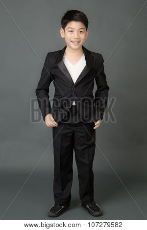 Portrait Of Asian Boy In A Business Suit,
