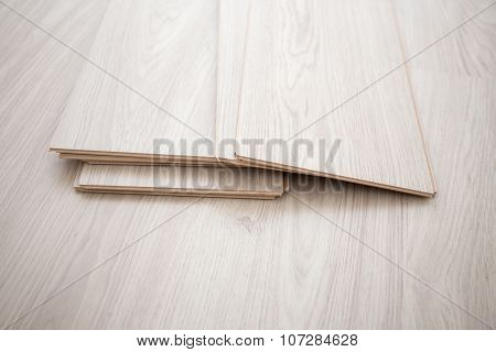 Close Up Of Wooden Parquet Pieces On Laminated Floor