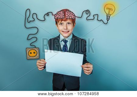Teen boy businessman business style holding a white sheet of pap