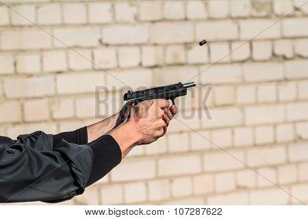 Man shooting with a pistol gun