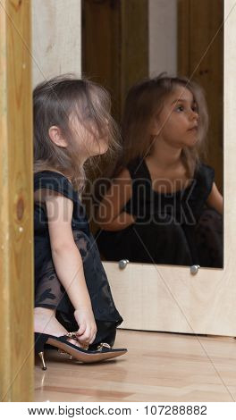 Little Girl Reflected In Mirror