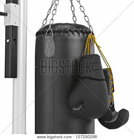 Boxing gloves hanging on punching bag, zoomed view