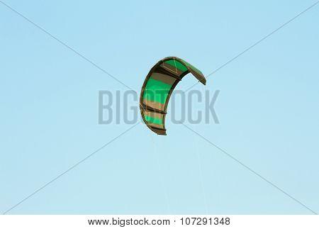 The kitesurf wing over blue sky