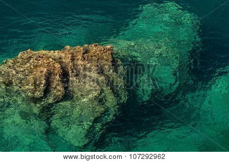 The rock rises from a seabed