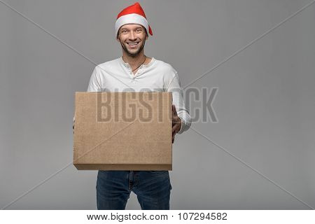 Cheerful Young Man In A Santa Hat