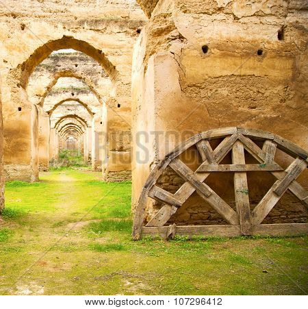 Old Moroccan Granary In The Green Grass And Archway  Wall