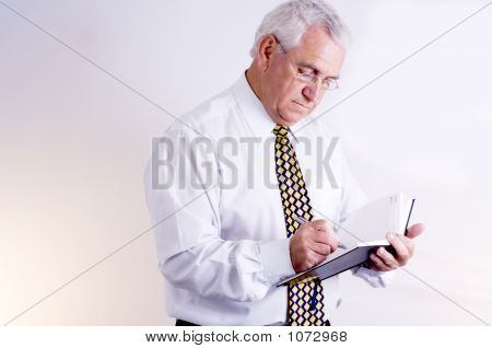 Mature Business Man Making Note
