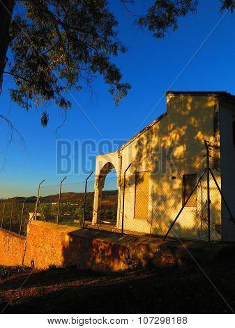 Derelict Building Behind Fence