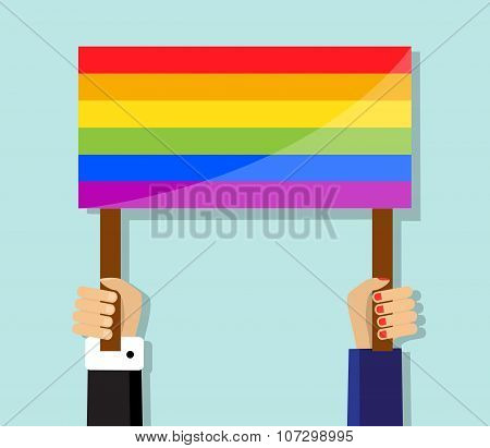 hand holding a gay pride flag