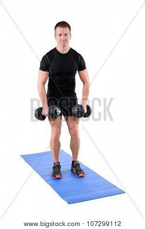 young man fitness instructor shows starting position of standing dumbbell lateral raise, isolated on white