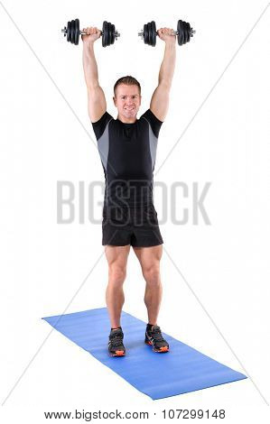 young man fitness instructor shows finishing position of standing dumbbell shoulder press, isolated on white
