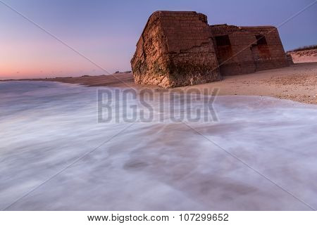 Bunker in ruins on the beach