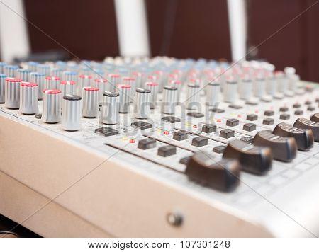 Closeup of music mixer in studio