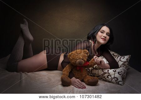 Beautiful young woman in brown body suit